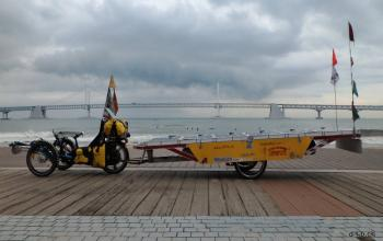 Solar and human powered trike project stranded in Busan